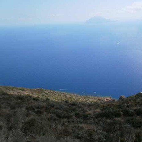 The blue of the water and the gorgeous view of Filicudi from the top of the volcano in Alicudi
